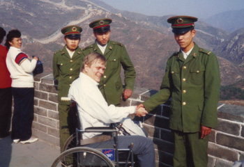 """Xie Xie. Thanks a lot!"" says traveler Lex Frieden to the Chinese military recruits who volunteered to carry him (and his wheelchair) up hundreds of steps onto the Great Wall."