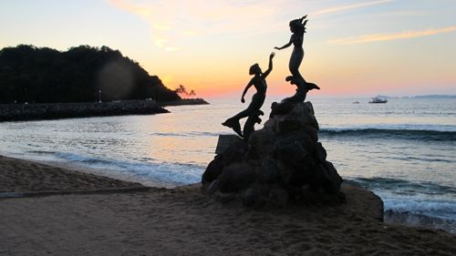mermaids sunset