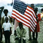 Children carry a flag in the Selma to Montgomery march