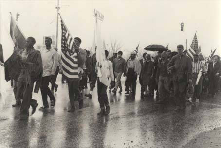Marchers walking in the rain in Montgomery during the Selma to Montgomery March (Courtesy Alabama Department of Archives and History)